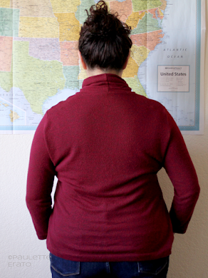 Back view of curly haired Latina woman in a red Kwik Sew 4069 turtleneck sweater, copyright Paulette Erato