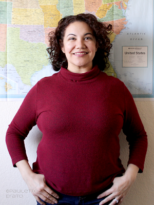 Curly haired Latina woman in a red Kwik Sew 4069 turtleneck sweater, copyright Paulette Erato