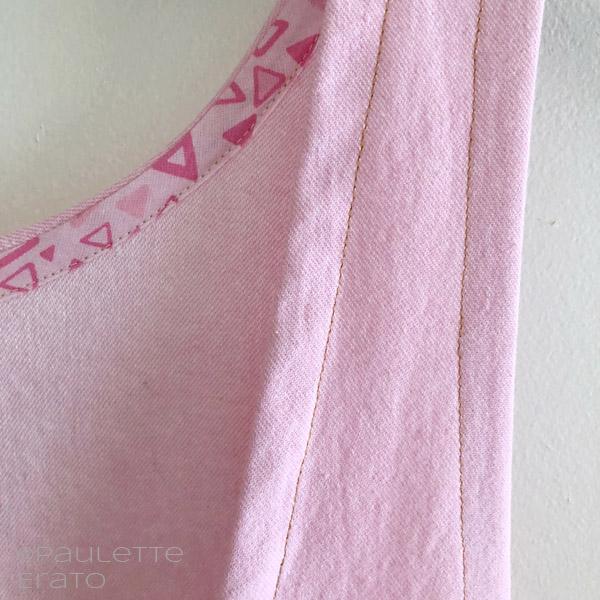 Pink bias binding on inside of a handmade pink denim York Pinafore pattern
