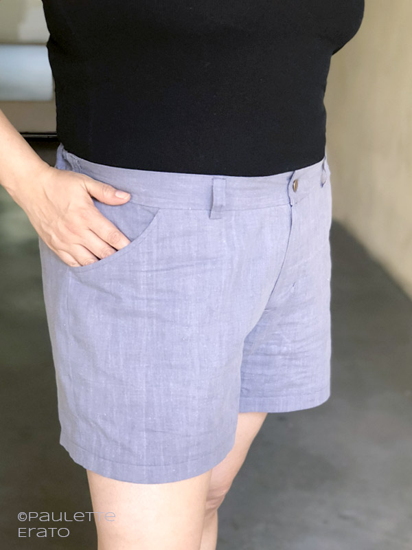 Zoomed in view of a woman's light blue Lander shorts with her hand reaching into her front side pocket