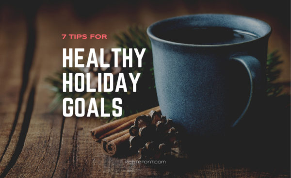 Image of a coffee cup with a cinnamon stick and acorn on table next to it. Text overlay reads 7 Tips for Healthy Holiday Goals, petite font dot com