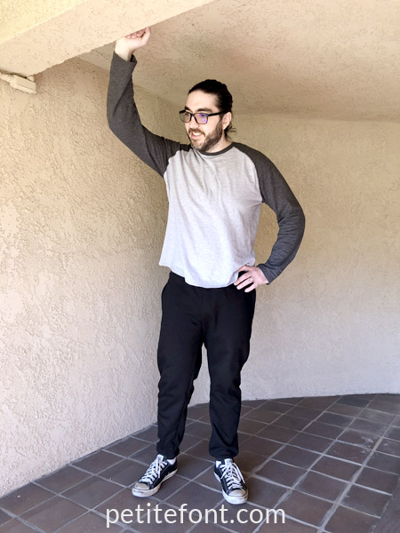 Simplicity 8268 Pattern Review: Joggers for Men, man in black sweatpants, one arm up in the air