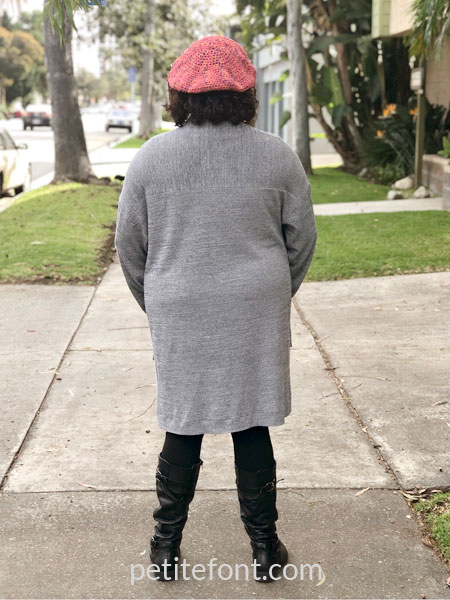 Como cardigan modeled from front on woman viewed from the back