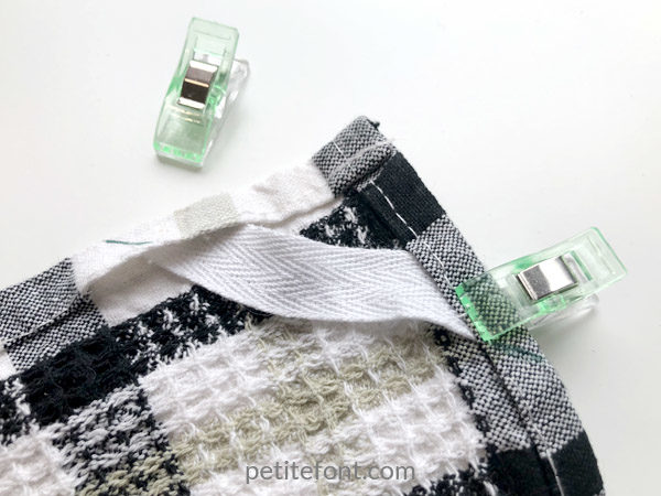 Easy to Sew Towel Hanging Loops Tutorial: tuck the tape under the open seams