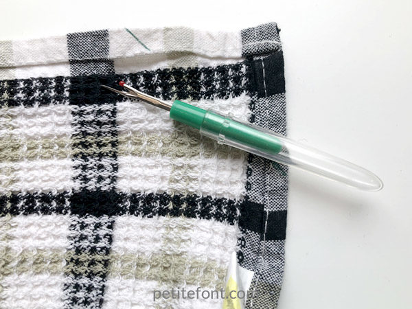Easy to Sew Towel Hanging Loops Tutorial: undo the seams so you can tuck your ribbon under
