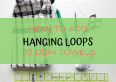 Materials needed for this include the towel, marking tool, scissors, thread, needle, seam ripper, ruler with text overlay How to Add Hanging Loops to Dish Towels