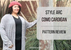 Como cardigan modeled from front on woman with one hand on a tree and text overlay Style Arc Como Cardigan Pattern Review