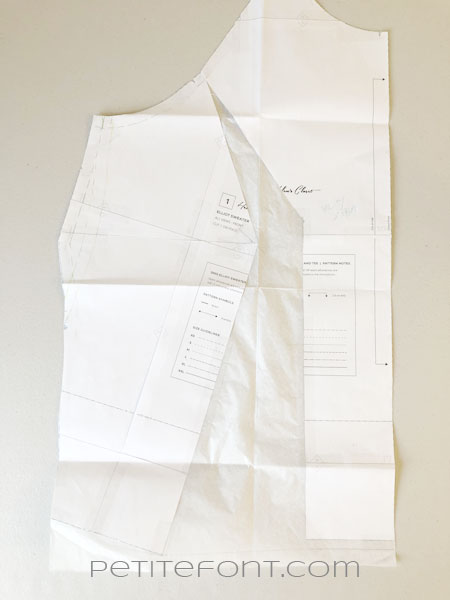 Altered front sewing pattern piece with medical paper inserted in gaps