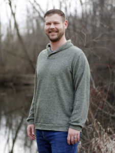 Bearded white man wearing Finlayson sweater in product promotion