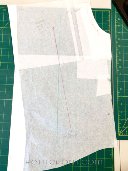 Back bodice pattern piece with 2 grainlines, one in red and one in blue colored pencil