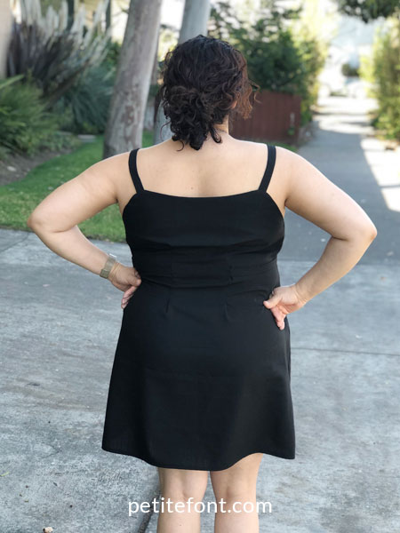 Free Heidi Day Dress in black fabric modeled on a woman viewed from the back