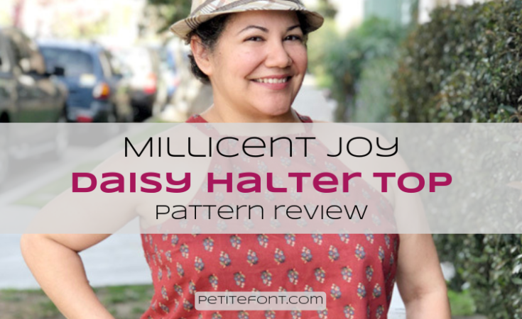 Smiling woman wearing a floral halter top with text overlay that reads Millicent Joy Daisy Halter Top Pattern Review, Petite Font dot com