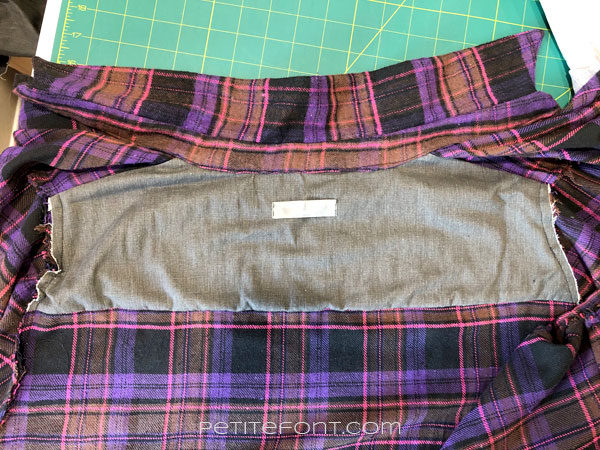 Inside view of a flannel shirt with grey yoke