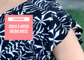 Image of a woman's shoulder and arm wearing a black and white dress and a pink square with text that reads pattern review chalk and notch orchid dress. Then a website address at the bottom that reads petite font dot com.