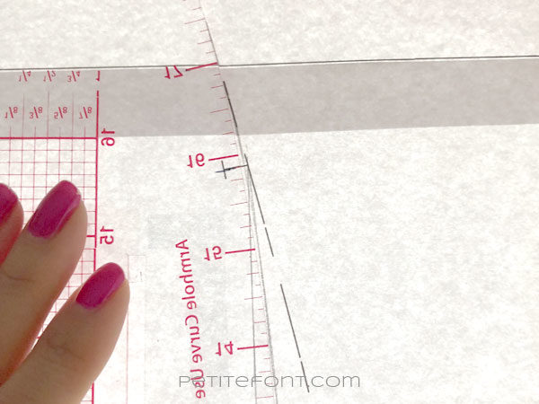 Image of curved ruler along the skirt pattern side seam showing how to smooth the seam