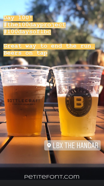 Image of two beers on a wooden table, text reads Day 100! hashtag the 100 day project hashtag 100 days of lbc. Great way to end the run. Beers on tap. LBX The Hangar.Petite font dot com