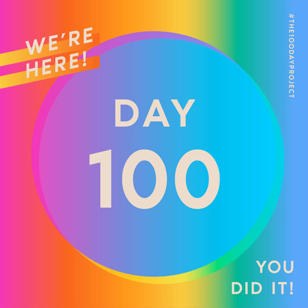 Rainbow with blue circle in middle. Text overlay reads We're here! Day 100. You did it!