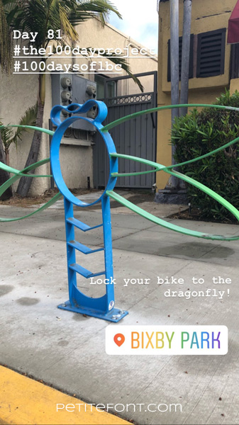 Image of dragonfly shaped bike rack on sidewalk. Text at top reads Day 81 hashtag the 100 day project hashtag 100 days of lbc. Text below reads Lock your bike to the dragonfly. Bixby Park. Petite font dot com.