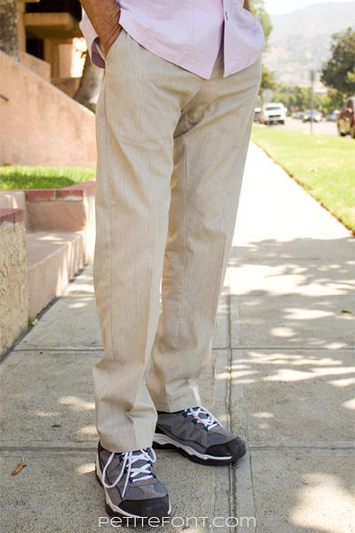 Lower half of man dressed in linen pants