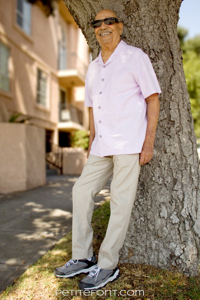 Man standing against tree in light colored linen Burda 6815 pants
