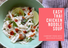 Bowl of easy Thai chicken noodle soup, or tom kha gai, next to a folded striped napkin with white text in a pink box that reads: Easy Thai chicken noodle soup, comfort food with delicious flavor. Petite Font dot com.