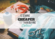 """Image of a light blue fabric in a vintage sewing machine with a pair of scissors on top, a thimble, thread, and orange measuring tape in the background with black text overlay that reads """"is sewing cheaper than buying clothes? petite font dot com"""""""