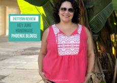 "Curly haired Latina woman in a pink silk and lace handmade sleeveless blouse standing in front of a palm tree with text overlay that reads ""pattern review hey june handmade Phoenix blouse, petite font dot com"""