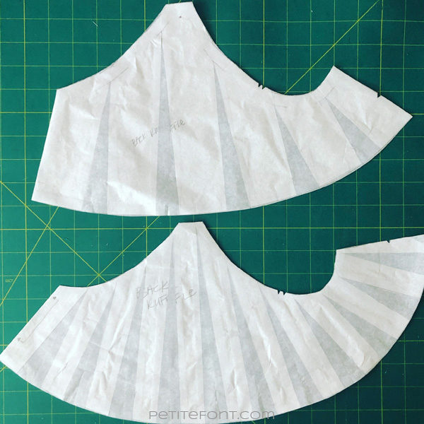 Comparison of two slash and spread ruffle pattern pieces, one with larger sections and less spread and another with smaller sections and more spread