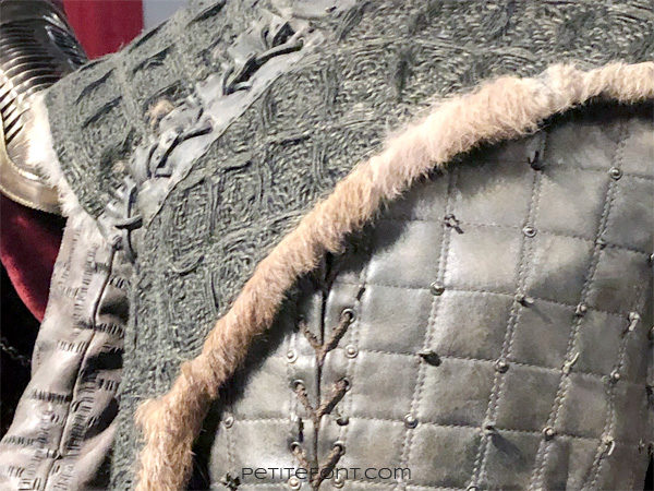 Detail of shoulder stitching on mannequin modeling Arya Stark's warrior outfit in the Game of Thrones costumes exhibition at FIDM Museum