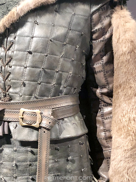 Detail of tunic on mannequin modeling Arya Stark's warrior outfit in the Game of Thrones costumes exhibition at FIDM Museum