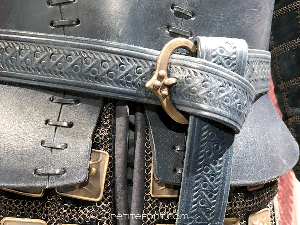 Detail view of belt of Ser Brienne's Lord Commander breastplate in the Game of Thrones costumes exhibition at FIDM Museum