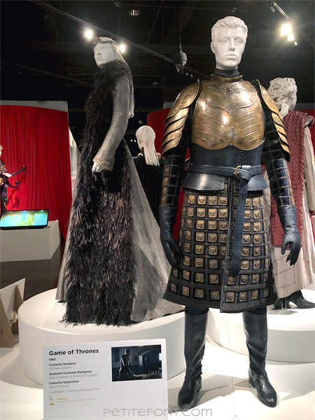 Mannequins modeling Sansa Stark's and Ser Brienne's outfits in the Game of Thrones costumes exhibition at FIDM Museum