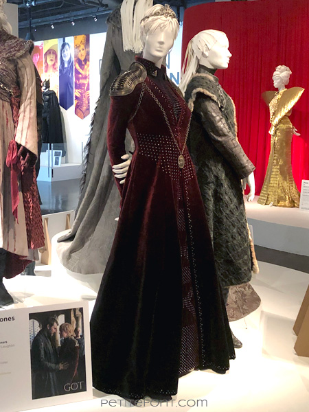 Mannequin in arrogant stance modeling Queen Cersei Lannister's outfit in the Game of Thrones costumes exhibition at FIDM Museum