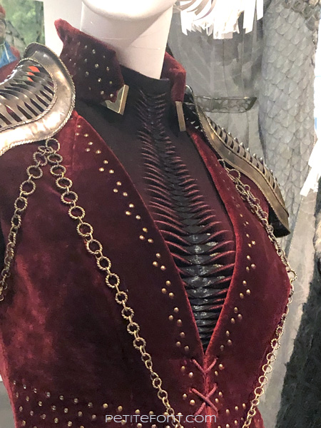 Detail shot of front pleating on a mannequin modeling Queen Cersei Lannister's outfit in the Game of Thrones costumes exhibition at FIDM Museum