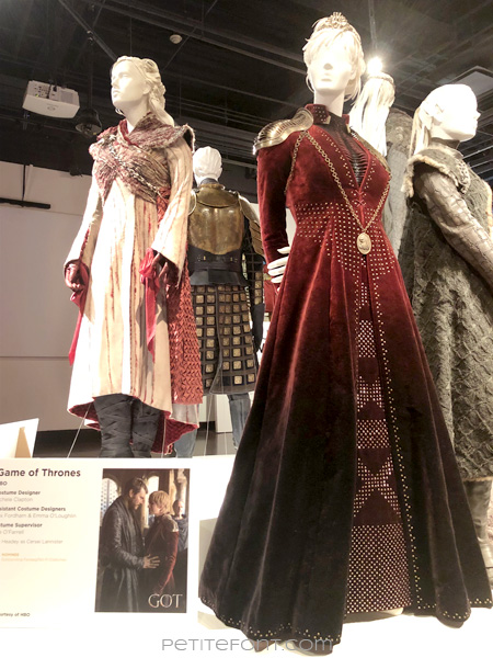 Mannequins modeling Queen Daenerys Targaryen's and Queen Cersei Lannister's outfits in the Game of Thrones costumes exhibition at FIDM Museum