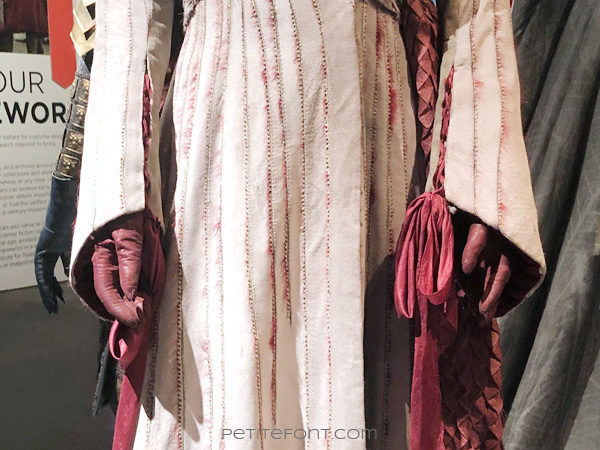 Detail of laced cuffs on Queen Daenerys Targaryen's costume in the Game of Thrones costumes exhibition at FIDM Museum