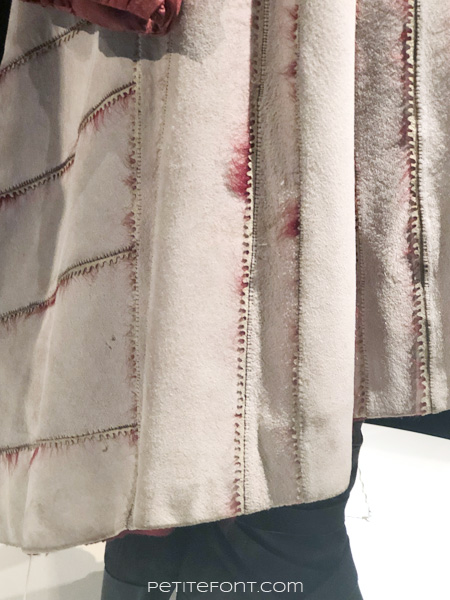 Detail of hem and back of dress on Queen Daenerys Targaryen's costume in the Game of Thrones costumes exhibition at FIDM Museum