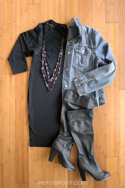Flatlay image of how to style a jean jacket for a date: black dress, jean jacket, statement necklace, and black thigh high boots
