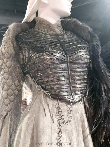 Detail of metal breastplate and skirt seaming of Sansa Stark's costume in the Game of Thrones costumes exhibition at FIDM Museum