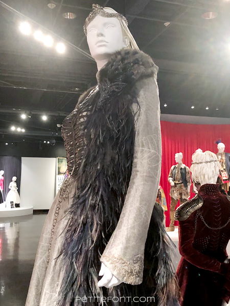 Detail of beaded direwolf shoulder of Sansa Stark's costume in the Game of Thrones costumes exhibition at FIDM Museum