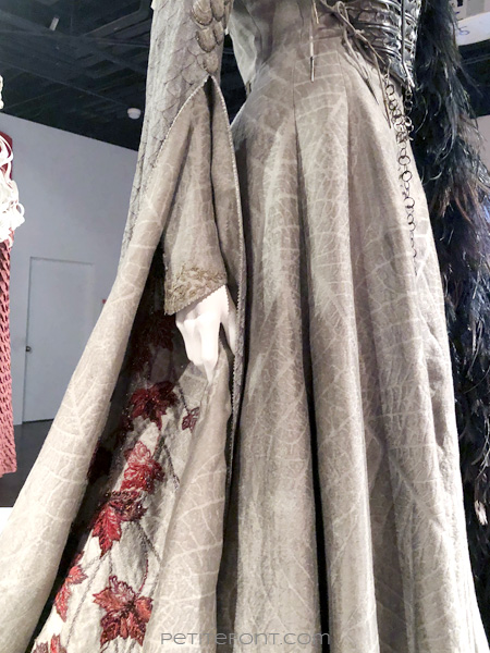 Detail of embroidered leaves and scales of Sansa Stark's costume in the Game of Thrones Costumes exhibition at FIDM Museum