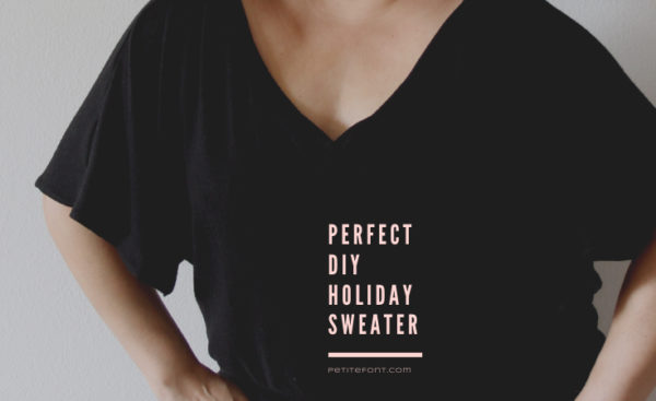Cropped image of a woman in a black v-neck sweater with short sleeves and light pink text overlay reads Perfet DIY Holiday Sweater, petite font dot com