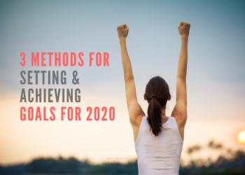 Back view of a woman in a white tank top with her hands up in a victory stance staring at the sunset with text overlay next to her that reads 3 Methods For Setting and Achieving Goals for 2020, petitefont.com