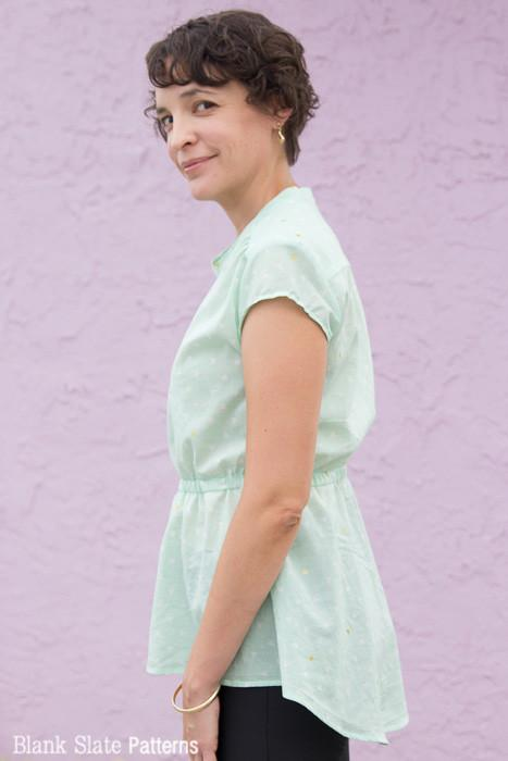 Side profile of a woman against a lavender wall in a light green Blank Slate Patterns Marigold Tunic
