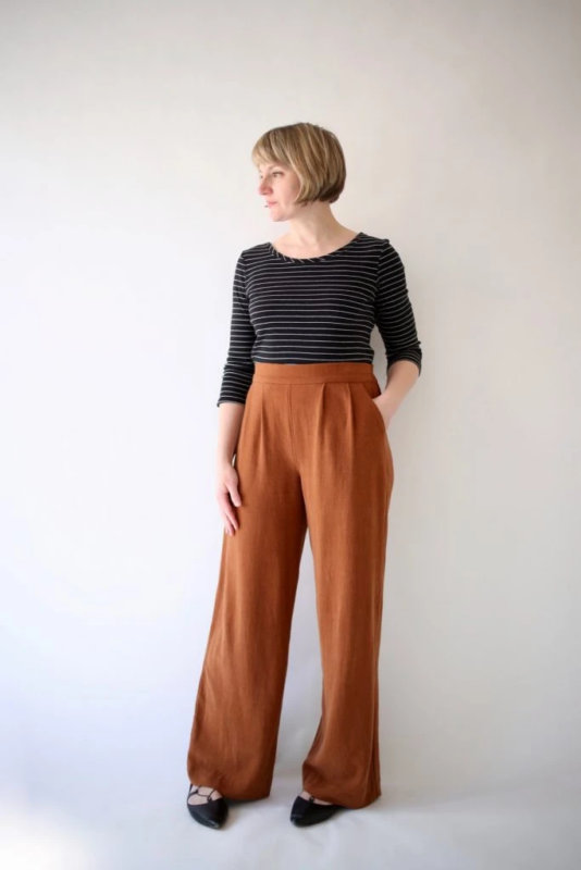 Woman against a white background in brown Made by Rae Rose Pants