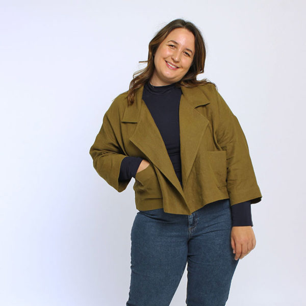 Woman against white background in an olive Helen's Closet Pona Jacket