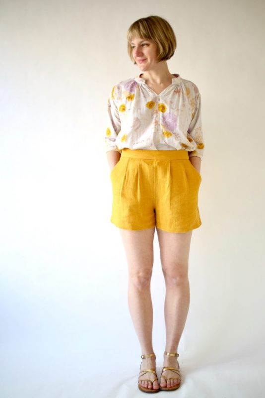 Woman against a white background in yellow Made by Rae Rose Shorts