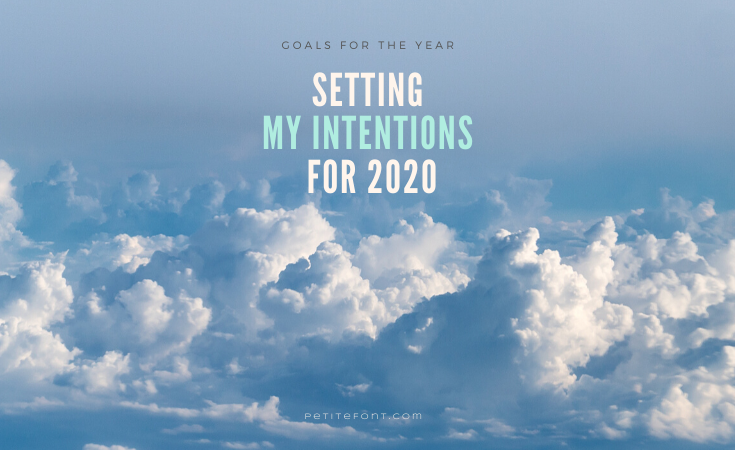 An expanse of poofy clouds in a blue sky with text that reads Goals for the Year: Setting My Intentions for 2020