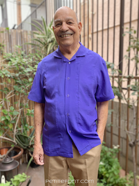 Elder bald man modeling a blue silk McCall's 7206 bowling shirt pattern in his patio garden