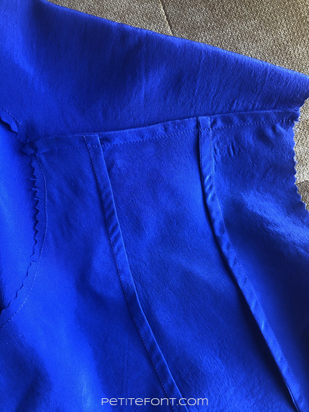 Interior seams of a blue silk version of McCall's 7206 men's sewing pattern showing French seams at shoulder and front bodice